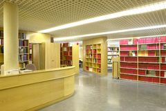 Public library interior with bookshelves and information desk. Educational. Nobody stock photo