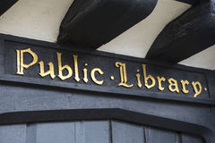 Public Library Vintage Sign. A traditional sign at a Public Library in Stratford-Upon-Avon, in the UK Royalty Free Stock Images
