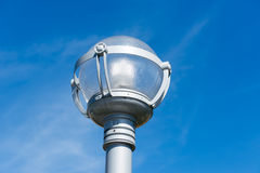 Public lightning system, street lamp in blue sky Stock Photography