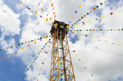 Public loudspeaker decorate by THAI and buddhism flag. The public loudspeaker in THAILAND decorate with flag of THAILAND and buddhism stock image