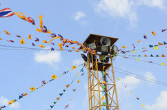 Public loudspeaker with flags. The public loudspeaker in THAILAND decorate with flag of THAILAND and buddhism royalty free stock images