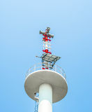 Public loudspeakers tower. On blue background stock photos