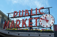 Public Market Sign With Clock Royalty Free Stock Image