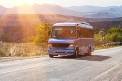 Public minibus drives along the road Royalty Free Stock Photo