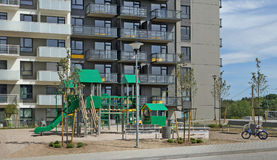 The public modern children playground near a new house Royalty Free Stock Photography