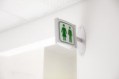 Public modern white and green restroom sign on white wall Royalty Free Stock Photos