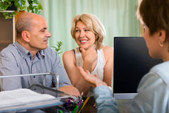 Public notary helping happy elderly couple to make a will Royalty Free Stock Photo