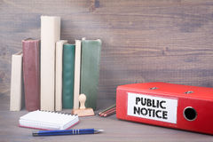 Public Notice. Binder on desk in the office. Business background stock photo