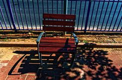 Public one person bench. Shot in the sunlight with some shade Royalty Free Stock Photos