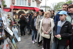 Public painter and buyer on Montmartre Royalty Free Stock Images