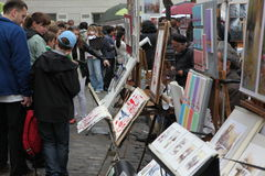 Public painter and buyer on Montmartre Stock Image