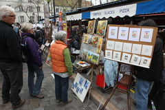 Public painter and buyer on Montmartre Royalty Free Stock Photo