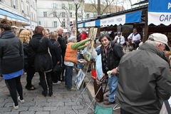 Public painter and buyer on Montmartre Stock Images