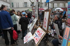 Public painter and buyer on Montmartre Stock Photo