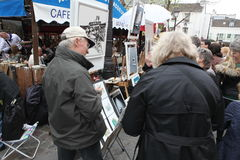Public painter and buyer on Montmartre Royalty Free Stock Image
