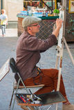 Public painter or street artist sketching a portrait outdoors. Heidelberg, Germany - September 24 2016. royalty free stock photography