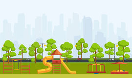 Public park with children playground. City park with trees, highway and overlooking the skyscrapers Royalty Free Stock Photo