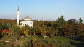 Public park in the fall. There is a mosque in the park. Mariupol Ukraine. Aerial video stock footage