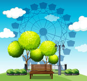 Public park with ferris  wheel in background Stock Photography