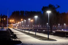 Public Park infrastructure, night lighting. Alley stock images