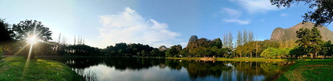 Public park at Phang-nga, Thailand. Nice view public park at Phang-nga province, Thailand. The sun is behind tree, river, trees and mountain Stock Photography