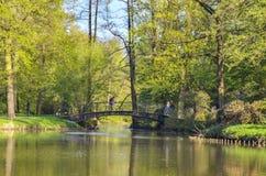 Public park in Pszczyna, Poland. PSZCZYNA, POLAND - APRIL 22, 2018: Tourists on the bridge in the beautiful castle park in Pszczyna, Poland Stock Photos