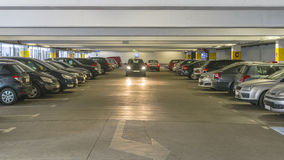 Public Parking Garage. Full of cars, parking under the roof in the building of the shopping mall in the Centre of Krakow royalty free stock photos