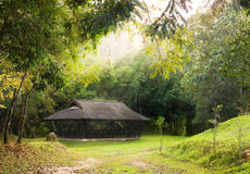Public pavilion round by green forest Stock Photo