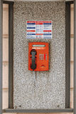 Public pay phone of red color in phone booth in St Petersburg Russia. Royalty Free Stock Photography