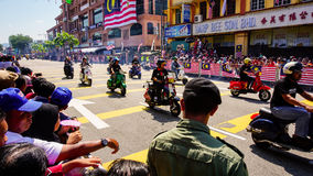 Motorcycles. Public peoples watching a convoy of motorcycles club at Malaysia national independance day Royalty Free Stock Photography