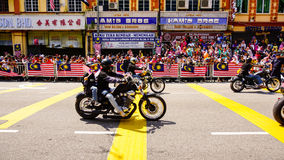Motorcycles. Public peoples watching a convoy of motorcycles club at Malaysia national independance day Royalty Free Stock Photo