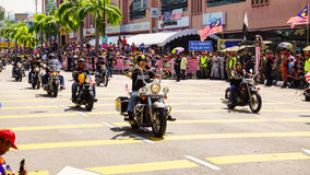 Motorcycles. Public peoples watching a convoy of motorcycles club at Malaysia national independance day Royalty Free Stock Image
