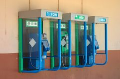 Public phone. Three African public phones usable with cards or coins outdoors in South Africa Royalty Free Stock Photos