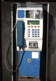 Public Phone. Roadside Public Phone in metal booth Stock Image