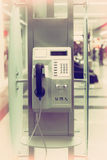 Public phone in airport hall Royalty Free Stock Images