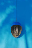 Public Phone on Blue Wall Background Stock Photos