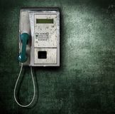 Public phone on green background Royalty Free Stock Image