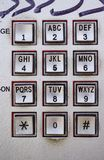 Public phone metal console with different buttons Stock Photography