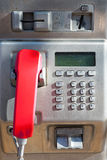 Public phone with a red handset Royalty Free Stock Image