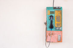 Public phone using coin or card setting on the wall. With empty Royalty Free Stock Photography
