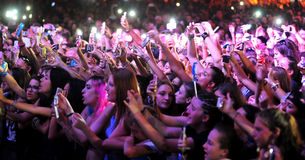 Public with the phones at the concert Royalty Free Stock Images
