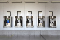 Public phones in hall and granite floor Royalty Free Stock Photos