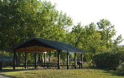 Public Picnic Shelter in an Open Space Park Area Royalty Free Stock Images