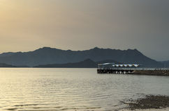 Public Pier at Twilight. A public pier at twilight with a mountain in the back Royalty Free Stock Photography