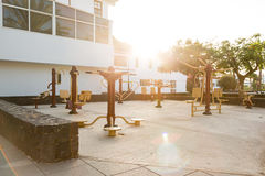 Public playground with outdoor fitness machines Royalty Free Stock Image