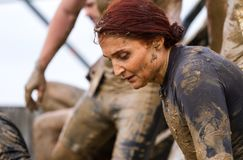 Public race with obstacles. Kyiv, Ukraine 2017 - September 2. Portrait of a woman during an obstacle overcome by a public race with obstacles. Autumn stock photography