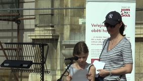 Olomouc, Czech Republic, April 12, 2018: The public reading of Holocaust victims in the city of Olomouc, people stand