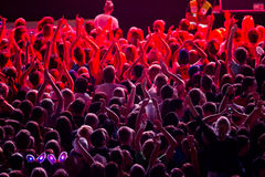 Public in red spotlight royalty free stock image