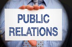 Public relations - het teken van de Zakenmanholding Stock Foto's