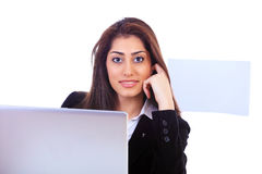 Public relations lady. Beautiful public relations lady sitting at office desk with laptop Stock Images